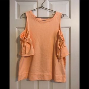 Peachy orange colored sweater. Short sleeved